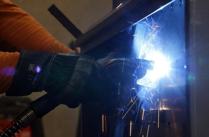 A worker welds in a factory in Gravellona Lomellina, 45km (27 miles) southwest of Milan, June 11, 2013. REUTERS/Stefano Rellandini/Files