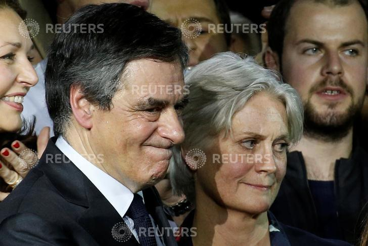 Francois Fillon, member of Les Republicains political party and 2017 presidential candidate of the French centre-right, and his wife Penelope attend a political rally in Paris, France, January 29, 2017. Picture taken January 29, 2017. REUTERS/Pascal Rossignol/Files