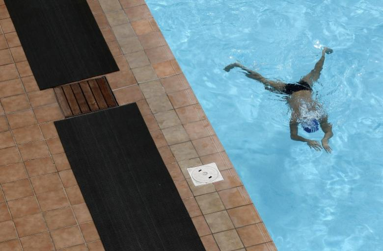 A man swims in a pool in Auckland September 29, 2011.  REUTERS/Stefan Wermuth