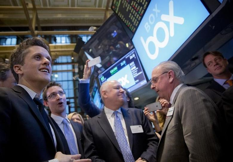 Online data storage provider Box Inc Co-Founder and CEO Aaron Levie (L) and Co-Founder and CFO Dylan Smith (2nd L) celebrate their company's IPO on the floor of the New York Stock Exchange January 23, 2015.  REUTERS/Brendan McDermid