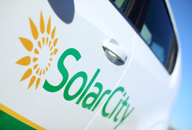 A Solar City logo is seen on the side of a company vehicle in San Diego, California, U.S., November 2, 2016.   REUTERS/Mike Blake