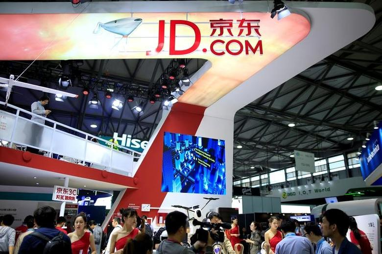 A sign of China's e-commerce company JD.com is seen at CES (Consumer Electronics Show) Asia 2016 in Shanghai, China, May 12, 2016. REUTERS/Aly Song/File Photo