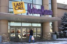 File Photo:  A customer walks by the Neiman Marcus Last Call store in Golden, Colorado January 23, 2014.  REUTERS/Rick Wilking