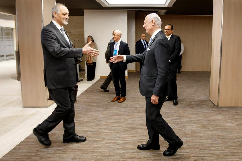 Bashar al-Jaafari (L), Syrian chief negotiator and Ambassador of the Permanent Representative Mission of the Syria to UN New York, shakes hands with UN Special Envoy of the Secretary-General for Syria Staffan de Mistura, right, prior a round of negotiation, during the Intra Syria talks, at the European headquarters of the United Nations in Geneva, Switzerland March 3, 2017. REUTERS/Salvatore Di Nolfi/Pool