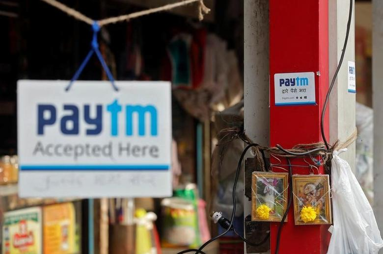 Advertisements of Paytm, a digital wallet company, are seen placed at stalls of roadside vegetable vendors in Mumbai, India, November 19, 2016. Picture taken November 19, 2016. REUTERS/Shailesh Andrade
