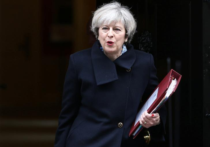 FILE PHOTO: Britain's Prime Minister Theresa May leaves Downing Street in London, Britain March 1, 2017. REUTERS/Neil Hall/Files
