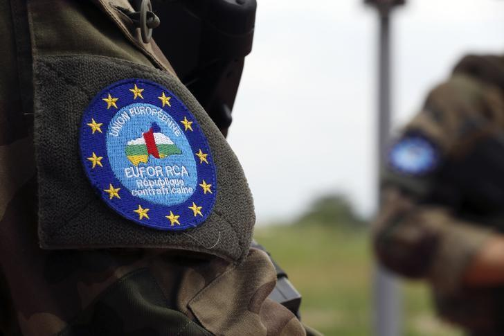 The logo of EUFOR-RCA European Union force is seen on a French soldier's uniform as they control a checkpoint at Bangui airport May 1, 2014. REUTERS/Emmanuel Braun