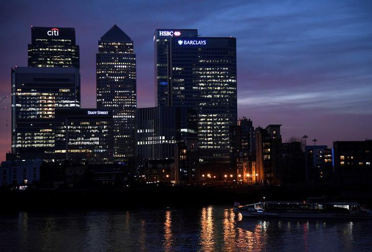 A river ferry passes in front of the Canary Wharf business district at dusk in London, Britain December 11, 2016. REUTERS/Toby Melville