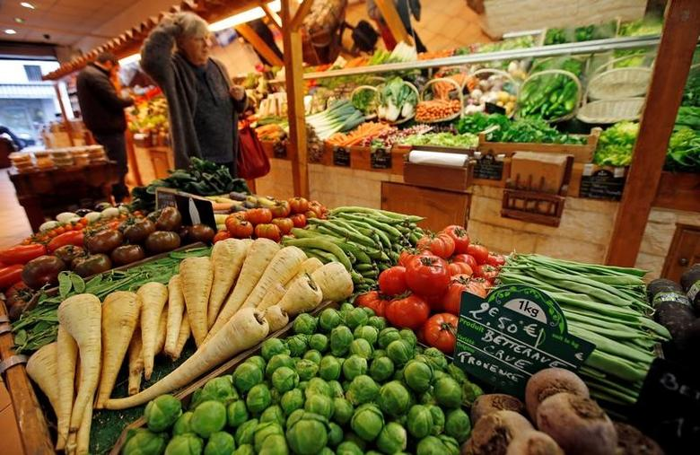 A customer chooses vegetables on a stall of a greengrocer in Marseille, France, February 9, 2017.  REUTERS/Jean-Paul Pelissier
