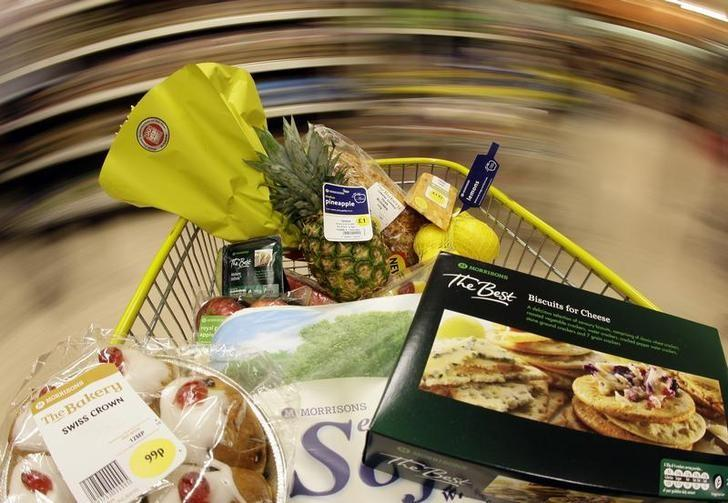 A shopping trolley is pushed around a Morrisons store in Coalville, central England September 10, 2009. REUTERS/Darren Staples