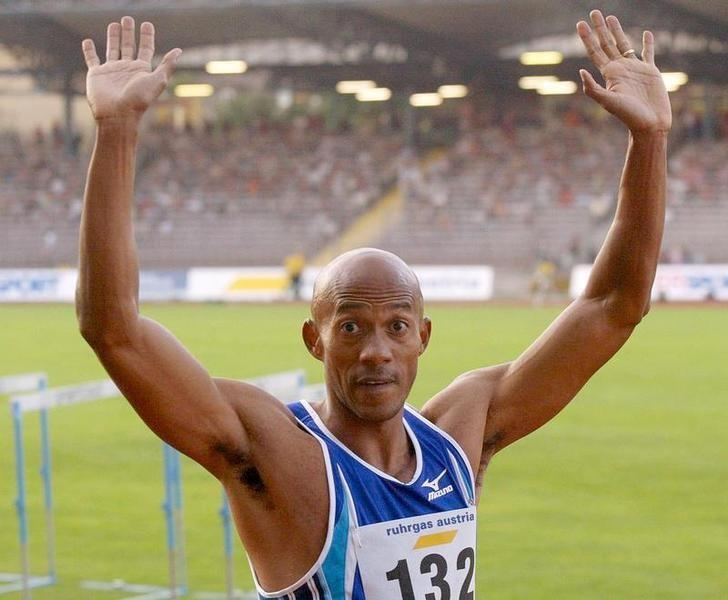 Frank Fredericks of Namibia celebrates after winning the 100 metresevent at an Athletics meeting in Linz on August 19, 2002. Frederickswon the race in a time of 10.19 seconds. REUTERS/Leonhard FoegerREUTERS/FilesLE/
