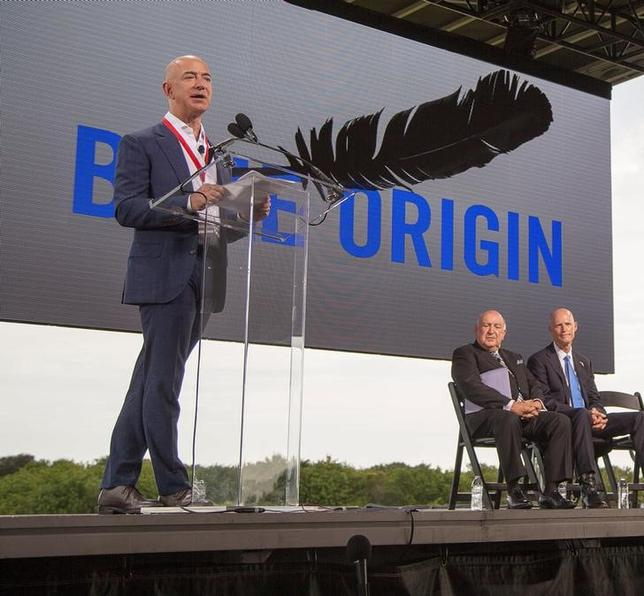 Amazon founder and Blue Origin founder Jeff Bezos (L)announces plans to build a rocket manufacturing plant and launch site at Cape Canaveral Air Force Station, Florida September 15, 2015.  HO/Mike Brown/Space Florida/Files