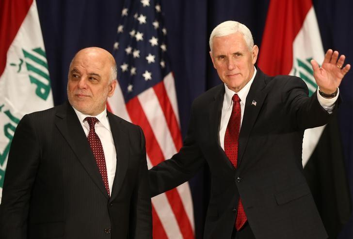 U.S. Vice President Mike Pence poses for a picture with Iraqi Prime Minister Haider Al-Abadi before their meeting at the 53rd Munich Security Conference in Munich, Germany, February 18, 2017.   REUTERS/Michael Dalder