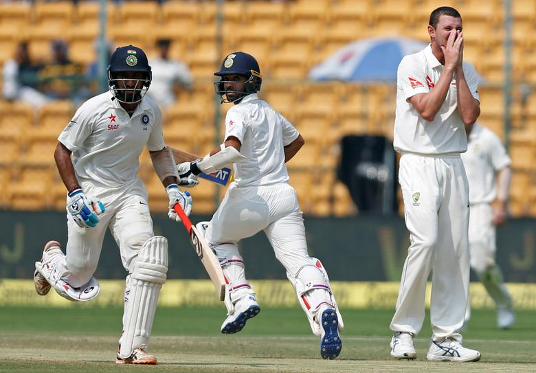Cricket - India v Australia - Second Test cricket match - M Chinnaswamy Stadium, Bengaluru - 06/03/17 - India's Cheteshwar Pujara and Ajinkya Rahane run between the wickets as Australia's Josh Hazlewood looks on. REUTERS/Danish Siddiqui/Files