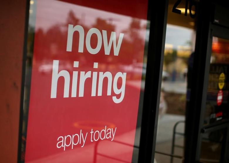 A department store advertises for workers in Encinitas, California, U.S., September 13, 2016. REUTERS/Mike Blake