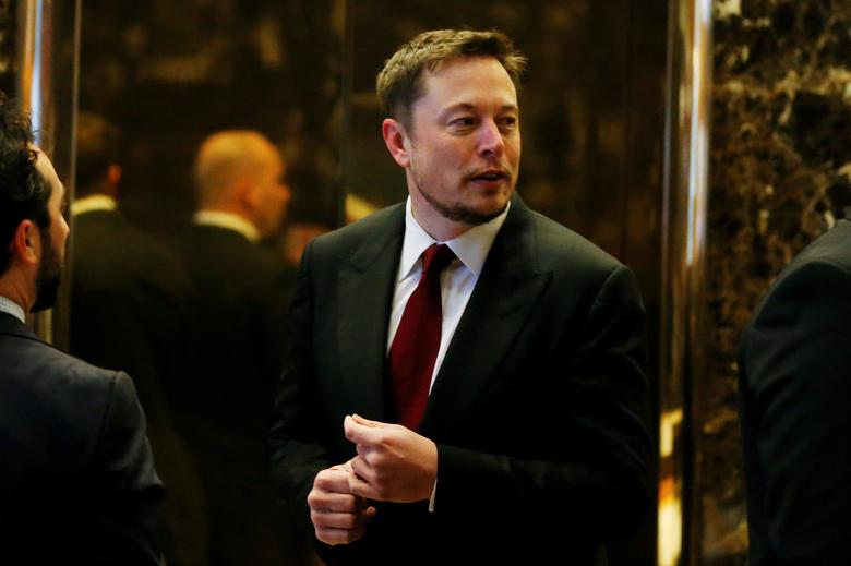 FILE PHOTO: Tesla Chief Executive, Elon Musk enters the lobby of Trump Tower in Manhattan, New York, U.S., January 6, 2017. REUTERS/Shannon Stapleton/File Photo