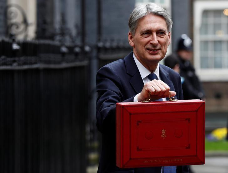 Britain's Chancellor of the Exchequer Philip Hammond stands outside 11 Downing Street before delivering his budget to the House of Commons in London, March 8, 2017. REUTERS/Stefan Wermuth