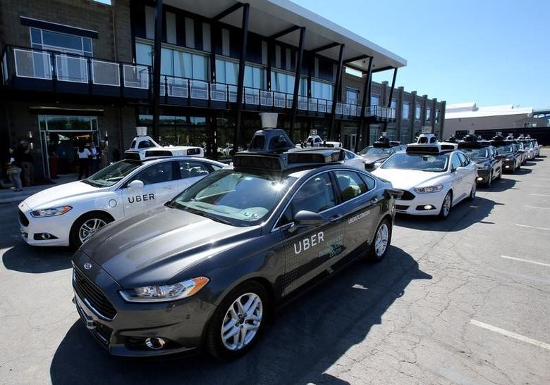FILE PHOTO: A fleet of Uber's Ford Fusion self driving cars are shown during a demonstration of self-driving automotive technology in Pittsburgh, U.S., September 13, 2016.     REUTERS/Aaron Josefczyk/File Photo