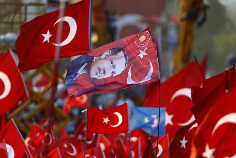 A flag with the picture of Turkey's President Tayyip Erdogan is seen during the Democracy and Martyrs Rally, organized by him and supported by ruling AK Party (AKP), oppositions Republican People's Party (CHP) and Nationalist Movement Party (MHP), to protest against last month's failed military coup attempt, in Istanbul, Turkey, August 7, 2016. REUTERS/Osman Orsal/Files