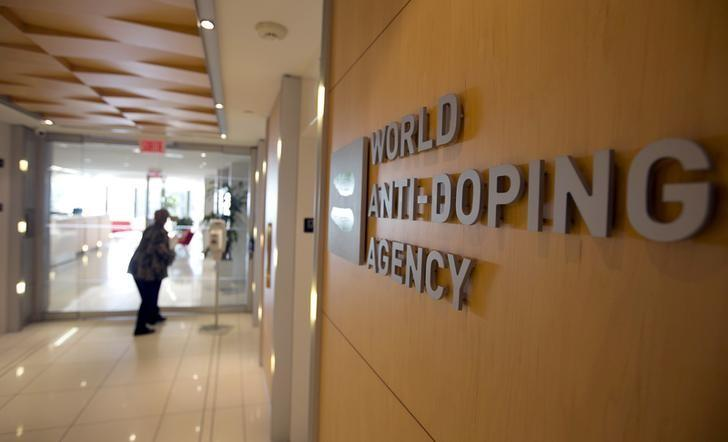 A woman walks into the head office of the World Anti-Doping Agency (WADA) in Montreal, Quebec, Canada November 9, 2015.  REUTERS/Christinne Muschi/Files