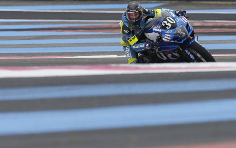 French rider Anthony Delhalle on Suzuki takes a curve during free practice for the Bol d'Or motorcycle endurance race at the Paul Ricard circuit in Le Castellet, France, September 17, 2015.  REUTERS/Jean-Paul Pelissier