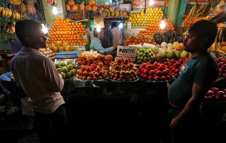 An advertisement of Paytm, a digital wallet company, is seen placed at a fruit stall in Kolkata, India, January 26, 2017. Picture taken January 26, 2017.  REUTERS/Rupak De Chowdhuri