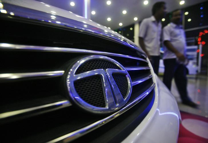 Men walk inside a Tata Motors showroom on the outskirts of Agartala, Tripura, November 7, 2012. REUTERS/Jayanta Dey/Files