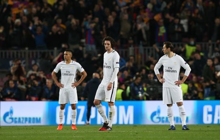 Football Soccer - Barcelona v Paris St Germain - UEFA Champions League Round of 16 Second Leg - The Nou Camp, Barcelona, Spain - 8/3/17 Paris Saint-Germain's Adrien Rabiot and team mates look dejected  Reuters / Albert Gea Livepic