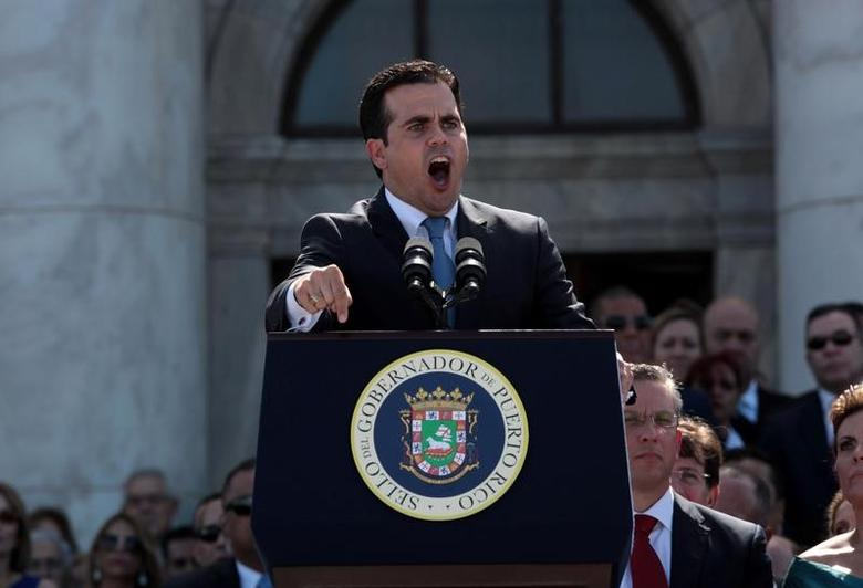 Puerto Rico's new governor Ricardo Rossello addresses the audience during his swear-in ceremony outside the Capitol in San Juan, Puerto Rico January 2, 2017. REUTERS/Alvin Baez