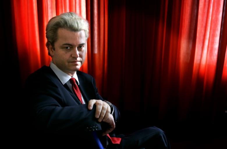 Maverick Dutch politician Geert Wilders poses for photographs inside the Dutch Parliament in The Hague October 21, 2004. REUTERS/Jerry Lampen