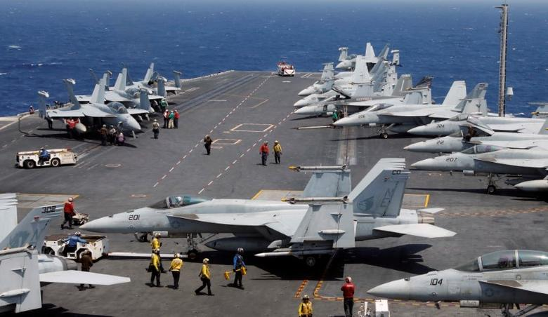 U.S. Navy personnel prepare to launch an F18 fighter jet on the deck of USS Carl Vinson during a FONOPS (Freedom of Navigation Operation Patrol) in South China Sea, March 3, 2017. REUTERS/Erik De Castro