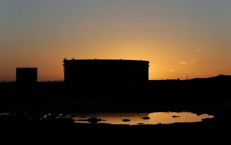 FILE PHOTO:  Damaged tanks are seen at the oil port of Ras Lanuf, Libya,  January 11, 2017.  REUTERS/Esam Omran Al-Fetori/File Photo