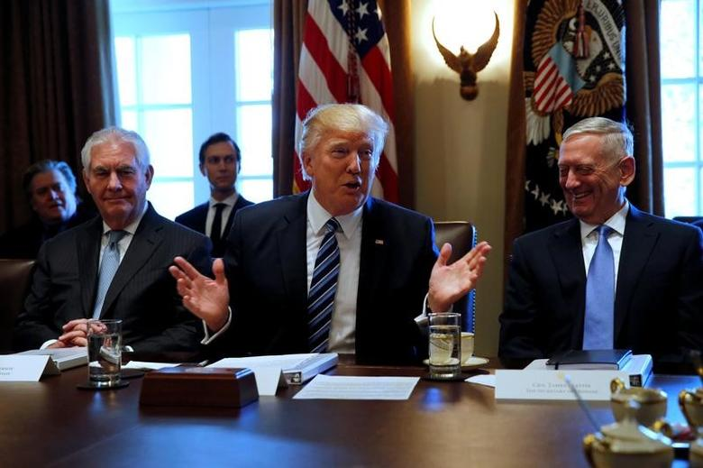 U.S. President Donald Trump (C), flanked by Secretary of State Rex Tillerson (L) and Defense Secretary James Mattis (R), holds a cabinet meeting at the White House in Washington, U.S. March 13, 2017. REUTERS/Jonathan Ernst - RTX30UWY