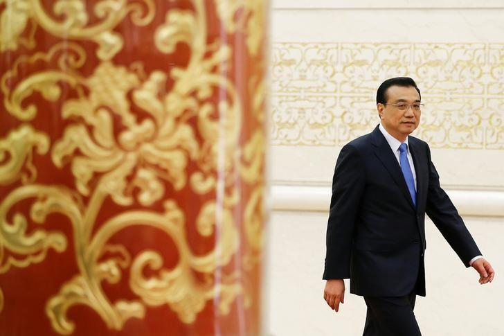 China's Premier Li Keqiang arrives for a news conference after the closing ceremony of China's National People's Congress (NPC) at the Great Hall of the People in Beijing, China, March 15, 2017. REUTERS/Damir Sagolj