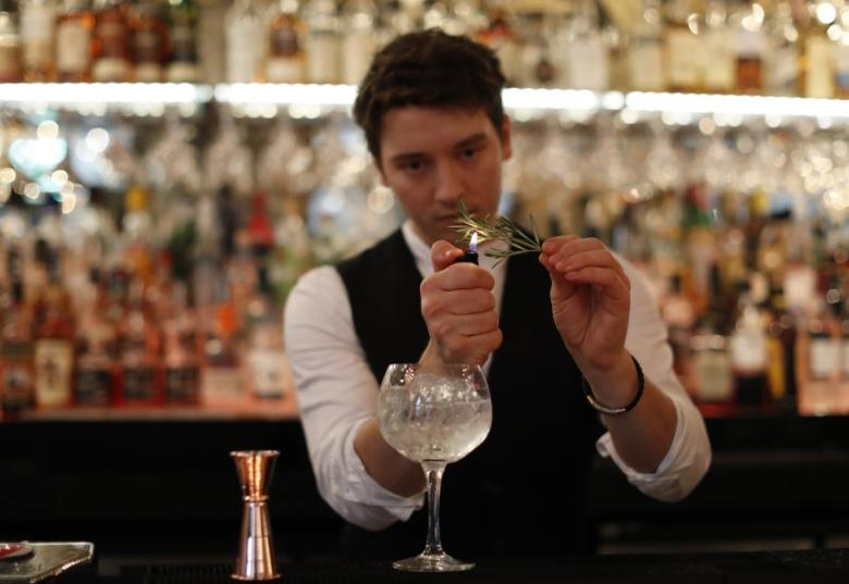 A barman prepares a Gin Cocktail at the Angels Share, Edinburgh, Scotland, Britain December 14, 2016. REUTERS/Russell Cheyne