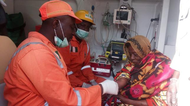 National Emergency Management Agency (NEMA) workers attend to a woman after suicide bombers detonated their explosives along Muna Garage in Maiduguri, Nigeria, March 15, 2017. NEMA/Handout via REUTERS