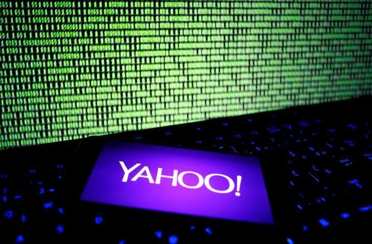 A photo illustration shows a Yahoo logo on a smartphone in front of a displayed cyber code and keyboard on December 15, 2016. REUTERS/Dado Ruvic/Illustration/Files