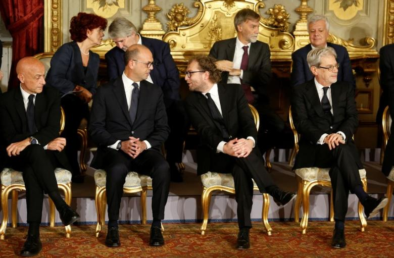 Newly appointed Italian Ministers talk during a swearing-in ceremony at Quirinale Palace in Rome December 12, 2016. First row (L-R): Interior Minister Marco Minniti, Foreign Minister Angelino Alfano, Sport Minister Luca Lotti, Minister for the South Claudio De Vincenti. Second row (L-R): Instruction Minister Valeria Fedeli, Labour Minister Giuliano Poletti, Infrastructure Minister Graziano Delrio, Environment Minister Gian Luca Galletti. REUTERS/Remo Casilli - RTX2UQ5H