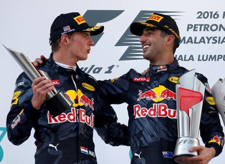 Formula One - F1 - Malaysia Grand Prix - Sepang, Malaysia- 2/10/16.  Red Bull's Daniel Ricciardo of Australia celebrates with Red Bull's Max Verstappen of the Netherlands on the podium. REUTERS/Edgar Su/File Photo