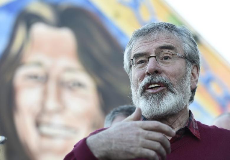 FILE PHOTO - Sinn Fein President Gerry Adams speaks to media outside the Sinn Fein offices on Falls Road in Belfast, Northern Ireland March 4, 2017.  REUTERS/Clodagh Kilcoyne/File Photo