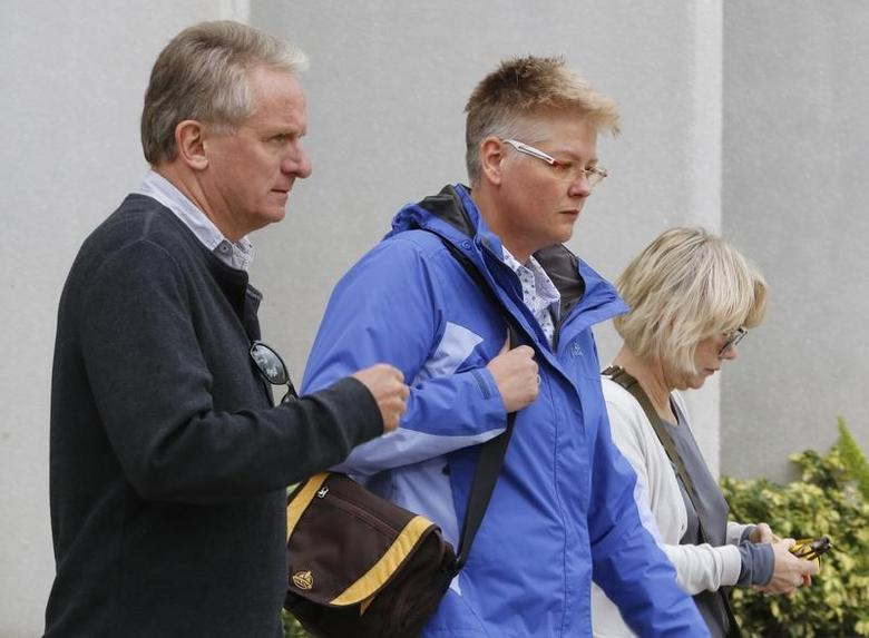 FILE PHOTO: Friends and family of Volkswagen executive Oliver Schmidt, who was arrested on charges of conspiracy to defraud the United States in connection with the automaker's emissions cheating scandal, walk from Federal court in Miami, Florida, U.S., January 9, 2017.    REUTERS/Joe Skipper