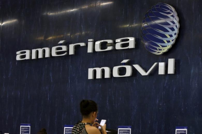 The logos of America Movil is seen on the wall of the reception area in the company's corporate offices in Mexico City August 12, 2015.   REUTERS/Henry Romero