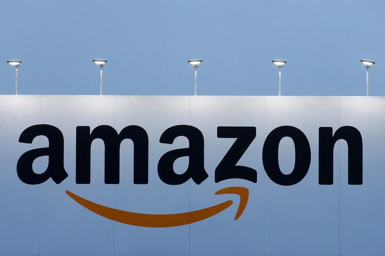 FILE PHOTO: The logo of Amazon is seen at the company logistics center in Lauwin-Planque, northern France on February 20, 2017. REUTERS/Pascal Rossignol/File Photo