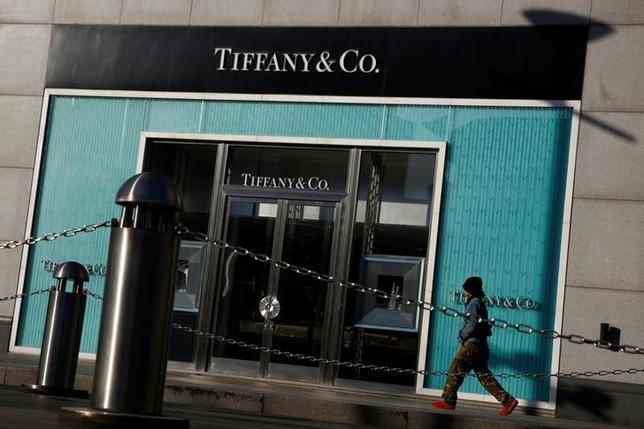 FILE PHOTO: A man walks past a boutique of the luxury jewelry retailer Tiffany & Co. in Beijing, China, December 1, 2016.  REUTERS/Thomas Peter/File Photo