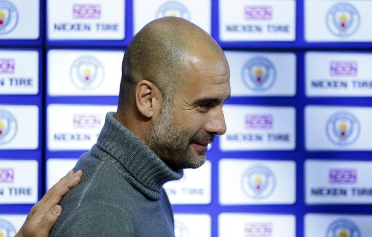 Britain Football Soccer - Manchester City announce sleeve partnership - City Football Academy - 17/3/17 Manchester City manager Pep Guardiola during the announcement of a partnership with Nexen Tire Action Images via Reuters / Ed Sykes Livepic