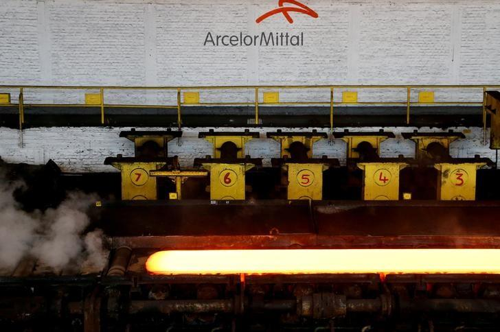 FILE PHOTO -  A red-hot steel plate passes through a press at the ArcelorMittal steel plant in Ghent, Belgium, July 7, 2016. REUTERS/Francois Lenoir/File Photo