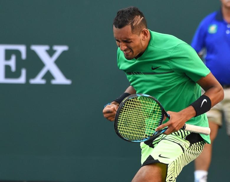 Mar 15, 2017; Indian Wells, CA, USA; Nick Kyrgios (AUS) reacts at match point as he defeats Novak Djokovic in the BNP Paribas Open at the Indian Wells Tennis Garden. Mandatory Credit: Jayne Kamin-Oncea-USA TODAY Sports