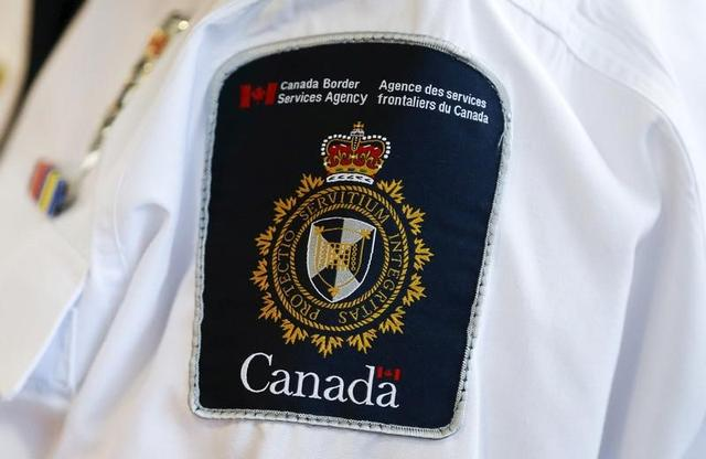 A Canada Border Services Agency (CBSA) logo is seen on a worker during a tour of the Infield Terminal at Toronto Pearson International Airport in Mississauga, December 8, 2015. REUTERS/Mark Blinch