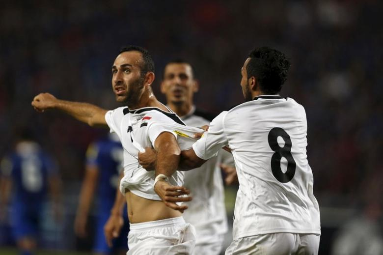 Iraq's Justin Meram (7) celebrates with teammate Ali Fesny Faisal (8) after scoring against Thailand during their 2018 World Cup qualifying soccer match at Rajamangala National Stadium in Bangkok September 8, 2015. REUTERS/Jorge Silva