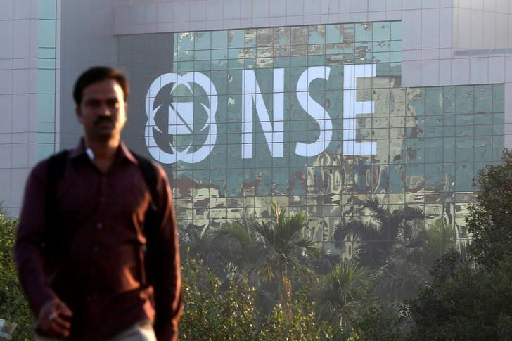 A man walks past the NSE (National Stock Exchange) building in Mumbai, India, December 27, 2016. Picture taken December 27, 2016. REUTERS/Shailesh Andrade